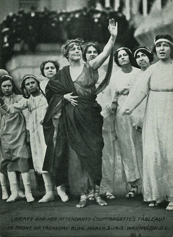 Women in a 1913 march on DC for suffrage.