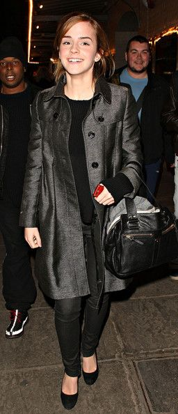 Emma Watson Wool Coat  Emma Watson pulled on a sleek gray wool trench for the premiere of 'The Damned United'. The knee-length coat polished off her monochromatic look.