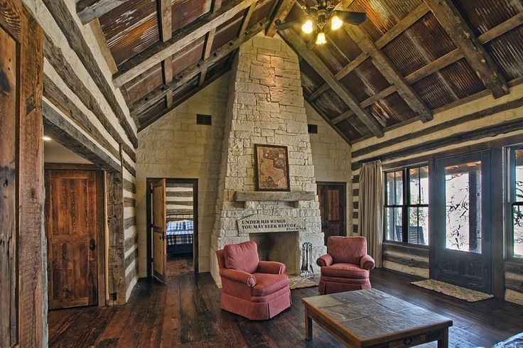 Log cabin in the texas hill country gathering room for Texas hill country cabin builders