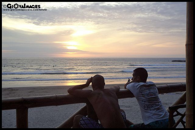 Montañita, Ecuador - Hostal Sole Mare. Guest looking at the view of the sunset