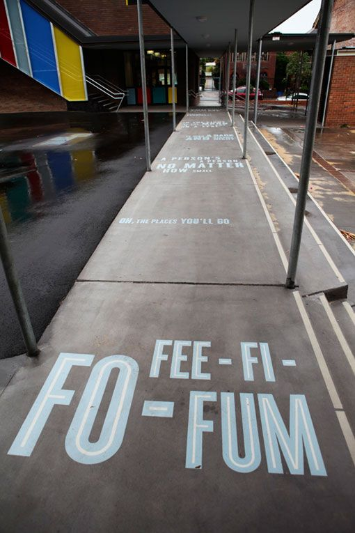 "Frost* Design recently put their stamp on the new library at Stanmore Public School, in Sydney, Australia, through the use of bright, col­our­ful, and playful typography. Such a great use of Cyclone font by H F & J. Here is a footpath with fee-fi-fo-fum. There's also ""Curiouser and curiouser"", and ""Oh, the places we'll go!"". Other touches include the See-Learn-Discover-MORE carpet. (More photos)"