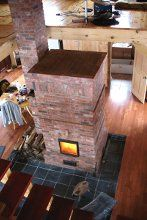Finnish style contraflow masonry heater with secondary combustion chamber oven.