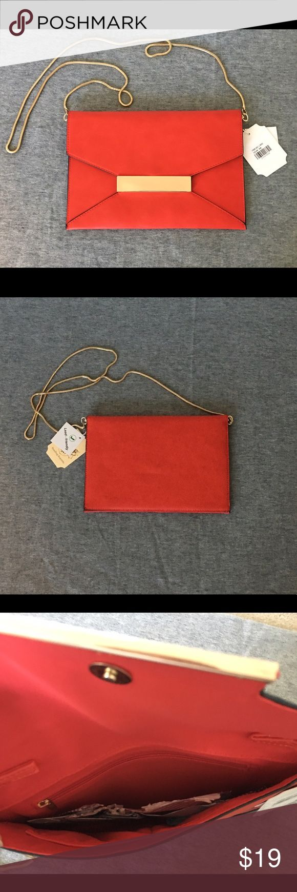 Red clutch with goldtone chain strap Faux leather flat clutch with zipper pocket and 2 slots. Detachable strap Bags Clutches & Wristlets
