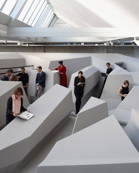 Experimental office that encourages workers to lean, perch or even lie down.