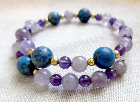 This physics bracelet is the perfect gift for your favorite science teacher, physics nerd, or sciart fashionista. Amethyst beads spell out the digits of the Bohr radius (truncated, admittedly), while genuine lapis lazuli beads and gold-colored base metal beads act as spacers between each digit.