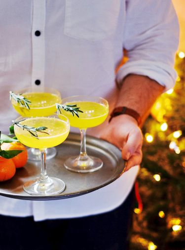 Seasons Greeting champagne cocktail  A simple, crowd pleasing cocktail, perfect for the holidays when  clementines are in season and I seem to buy them in abundance!