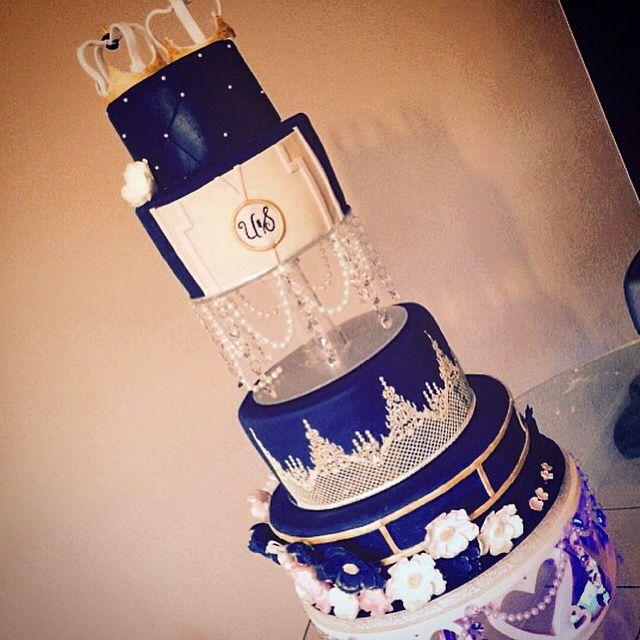 4 tier wedding cake with vanilla, chocolate and red velvet sponges, handmade sugar flowers, handmade sugar crowns and handmade cake stand & separator!
