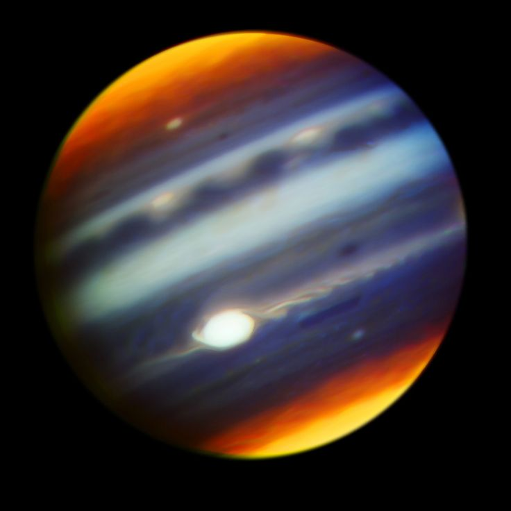This composite, false-color infrared image of Jupiter reveals haze particles over a range of altitudes, as seen in reflected sunlight was taken using the Gemini North telescope in Hawaii on May 18, 2017, in collaboration with observations of Jupiter by NASA's Juno mission. (Credits: Gemini Observatory/AURA/NASA/JPL-Caltech)
