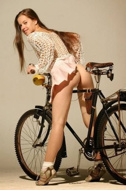 Naked woman on a bicycle 15