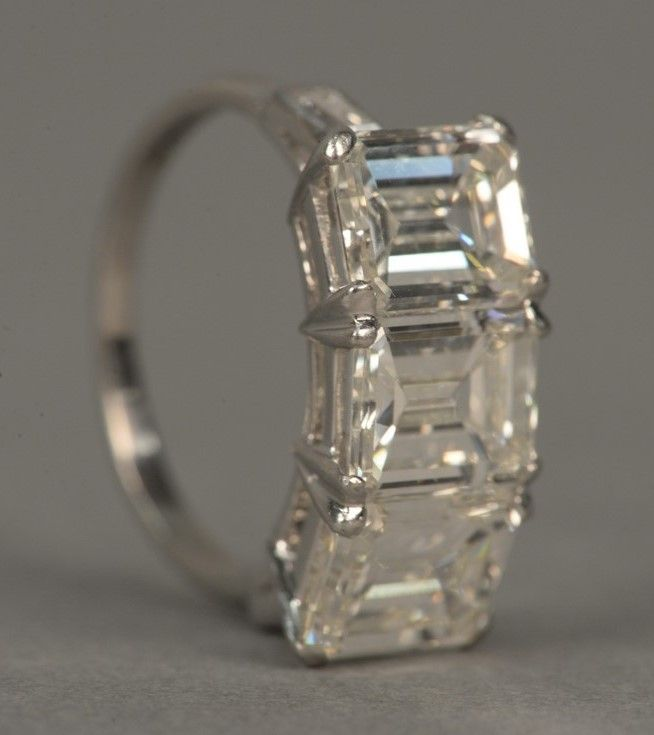 Platinum three stone diamond ring set with three emerald cut diamonds, each approximately 1.8cts. to 1.9cts. each ~ Realized Price $37,200.00   #nadeausauction
