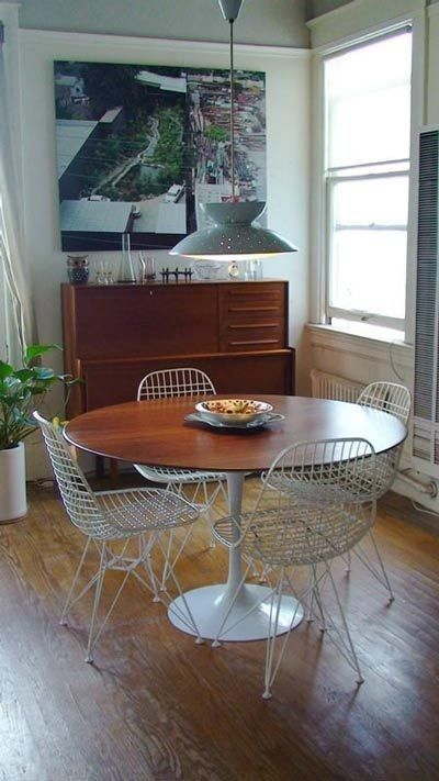 Saarinen Tables Across Apartment Therapy