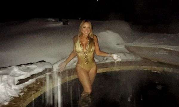 """The temperature must have been pushing zero, but that wasn't going to stop Mariah Carey from taking a Christmas dip while on holiday in Aspen, Colorado. The singer didn't seem like she was feeling the cold as she showed off her incredible figure in a golden bikini, standing knee deep in a hot tub. In the snap, which was posted on Boxing Day, she can be seen with snow on her hands. The caption is made up of the following hashtags: """"traditions"""", """"aspen"""", """"winter moments"""", and """"sending all my…"""