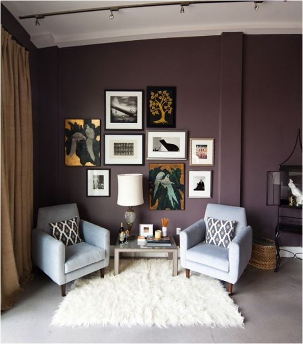 Love, love, love this living room. Plum paint on wall, furry/shag area rug, modern chairs, and gallery wall.