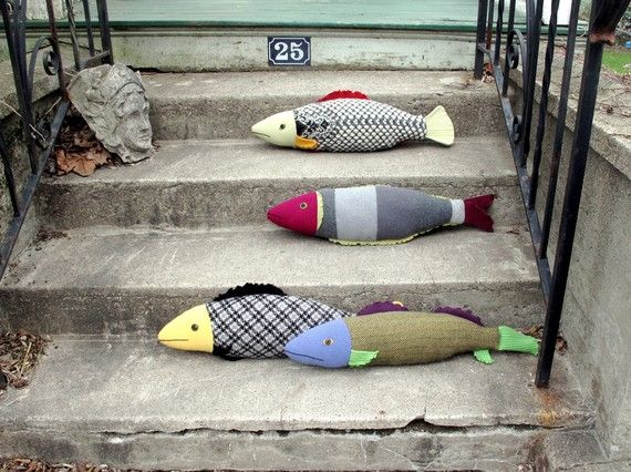 Recycled sweaters...I should try making something like these as draft guards for our home!
