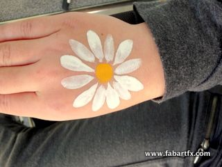 Simple daisy art... could be done a little smaller on a cheek.