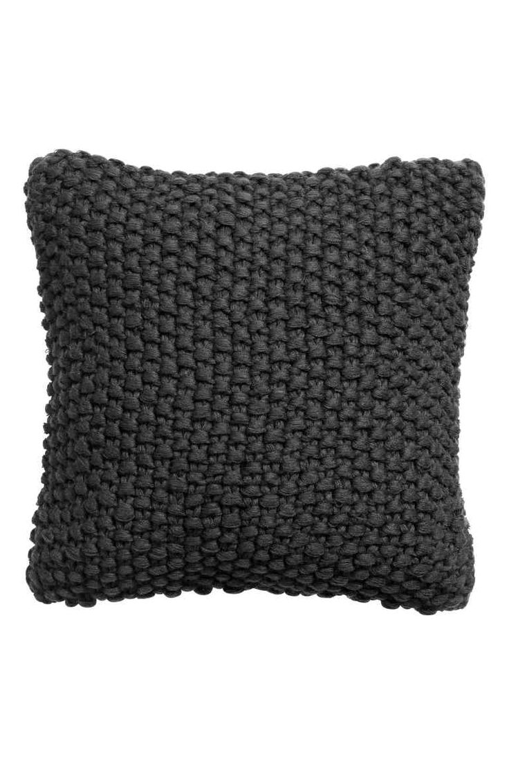 Moss-knit cushion cover: Moss-knit cushion cover with a woven back and concealed zip.