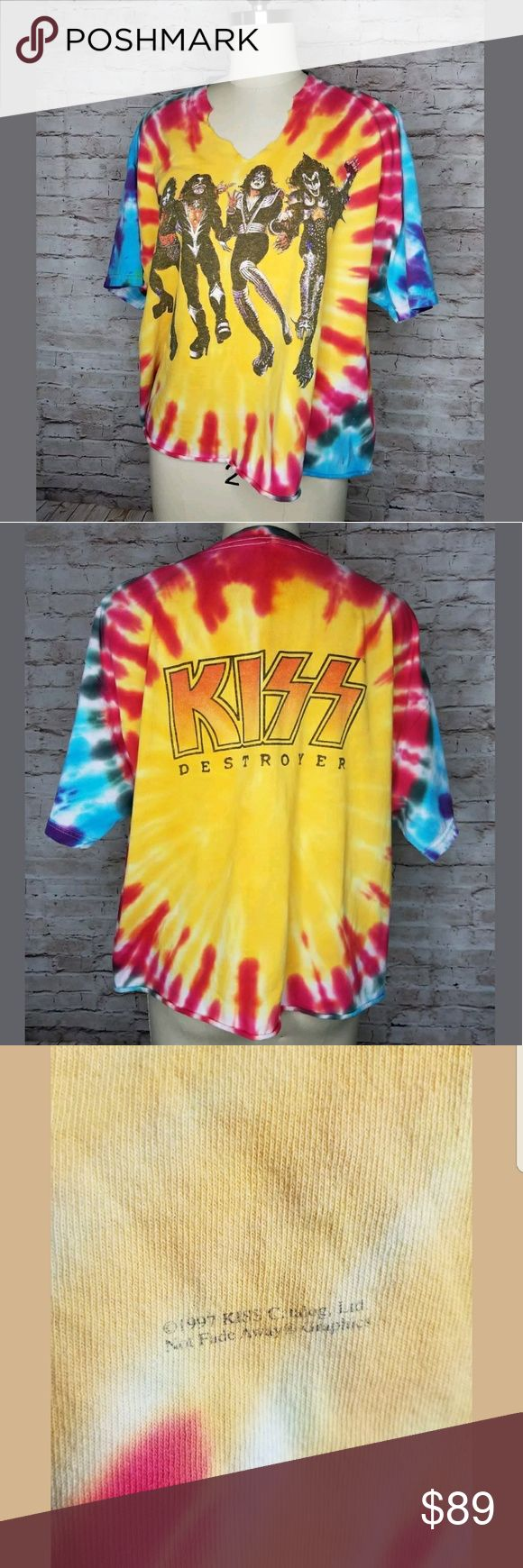 KISS Destroyer Tie Dye T-Shirt 1997 Album Cover Up for consideration is  a pre-owned vintage 90s tie-dye Kiss Destroyer band T. This top has had the collar cut into a v neck shape , and the bottom hem appears to have been cut off as well and is now unfinished. Top is in great overall condition, no size tag  , showing signs of normal wear. Lots of life left !!  Pit to pit approx 23in Shoulder to hem approx 21in Sleeve length approx 8in Pit to hem approx 10in  /ID/E unknown Tops Tees - Short…