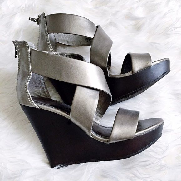 """Pewter Wedge Sandals These muted Metallic Pewter wedge sandals go with everything! They are comfortable and soft. 5"""" heel total height with a 1.5"""" platform for comfort. Worn twice, in excellent condition. A minor scuff on the back (shown on pic) due to packing in suitcase. Price negotiable:) Mossimo Supply Co Shoes Wedges"""