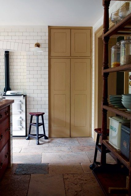 Will Fisher of Jamb has completely refashioned his 18th-century house in south east London, relaying the wooden antique floors, reproducing the cornicing and installing period chimneypieces and stonework. In the kitchen, flagstones were hand-tooled to the same size and depth.  Taken from the September 2013 issue of House & Garden
