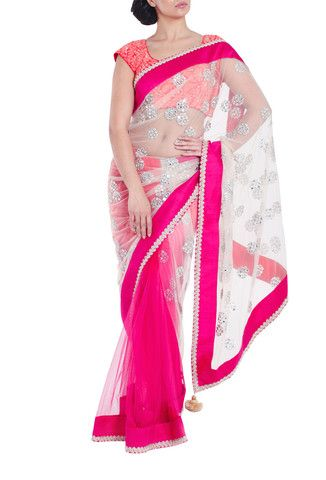 VIKRAM PHADNIS  'half and half' concept saree in pink and orange with silver net detail. Embellished with butta mirror work and pink raw silk borders with silver crochet detailing.   Matching semi-stitched embroidered blouse with cute capped sleeves included. #Saree #Indianfashion #Designersaree