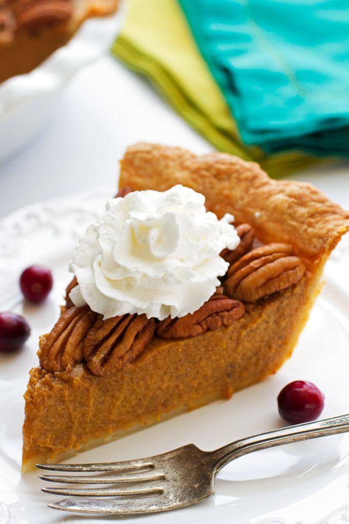 The Best Pecan Pumpkin Pie. A lusciously smooth pumpkin pie filling, a buttery crust, topped with toasted pecans. | Littlespicejar.com #pumpkinpie #pumpkinspice #fallrecipes