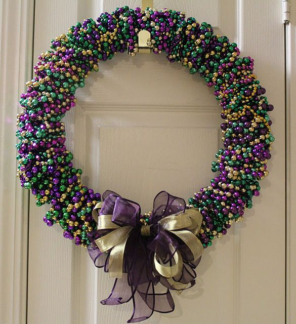 Mardi gras bead wreath. Would work in Christmas red and green with a snowflake attached. I'm going to do this.