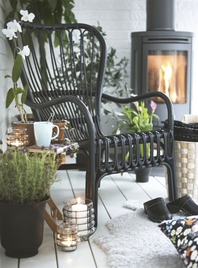 Storsele Black Rattan Chair, IKEA...would love a couple of these for the back porch