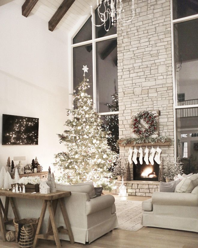 all white interior | white holiday decor | farmhouse living room |stone fireplace | exposed ceiling beams | shiplap ceiling | white oak flooring | interior design | interior decor @NC_HomeDesign