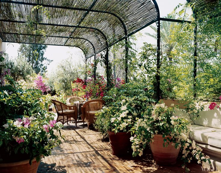 Socialite Marella Agnelli\'s terrace of her master-bedroom-suite shaded by a split -bamboo pergola and planted with bougainvillea designed by Madison Cox on her Marrakech estate.