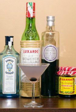 2 ozgin  1/2 oz Luxardo maraschino liquor  1/2 oz creme de violette  1/2 oz lemonjuice  1 real maraschino cherry  Shake with ice and pour into a cocktail glass.    Sink one real maraschino cherry for a garnish.