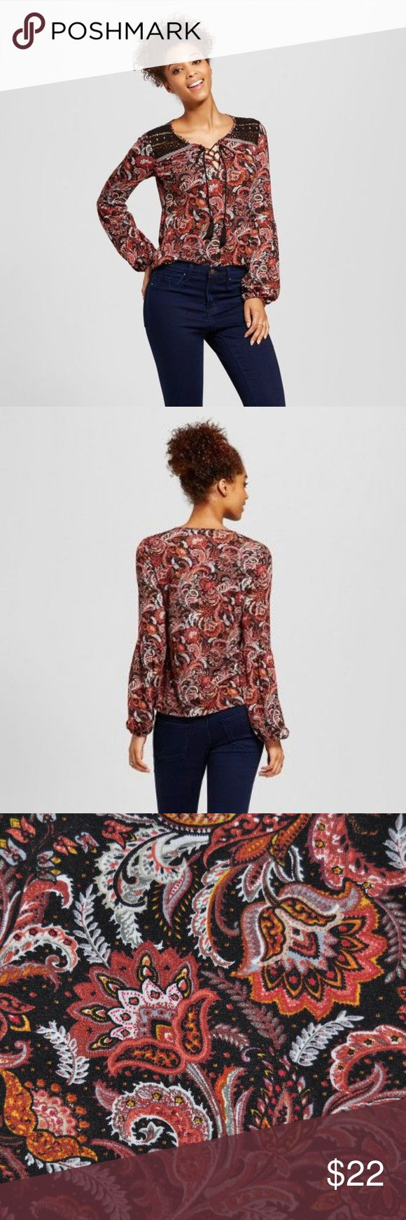 NEW Floral Printed Lace-Up Bishop Sleeve Top [D3] Whether you're looking for a date night look or a sweet top to wear to class, the Printed Bishop-Sleeve Top will instantly add a spark to your look. With the bold pattern, crochet panels on the yoke, lace-up neckline and bishop sleeves, this printed blouse is enough to dress up even the simplest skinny jeans.   size XS new without tags color: red multi  @cjrose25  tags: folk. bohemian. boho. hippie. gypsy. festival. Xhilaration Tops Blouses