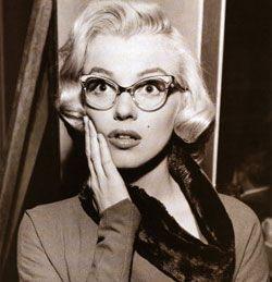 Marilyn Monroe in sexy geeky glasses.