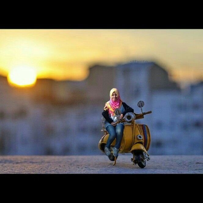 Mini people with vespa bike