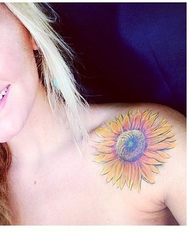 sunflower tattoo. Really love them but I don't know where I'd place it.
