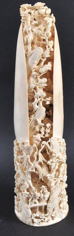 A FINE 19TH CENTURY CHINESE CARVED CANTON IVORY TUSK unusually formed as an open shell with internally carved mountainious landscape, with figures in various pursuits.
