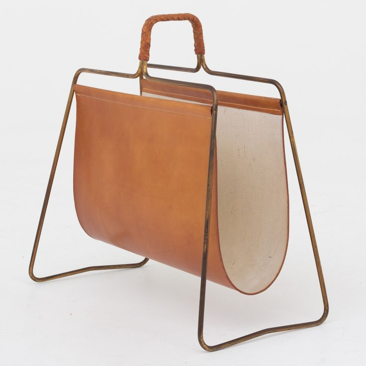 Magazine holder in leather
