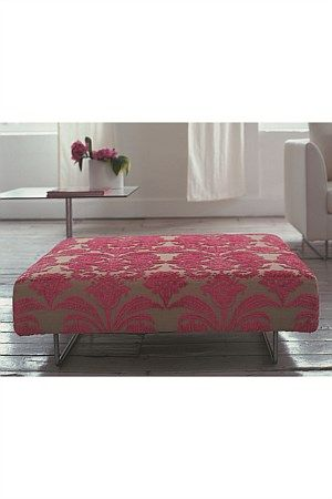 A sleek tailored footstool. With its clean cut shape and luxurious velvet fabric this design provides excellent comfort.