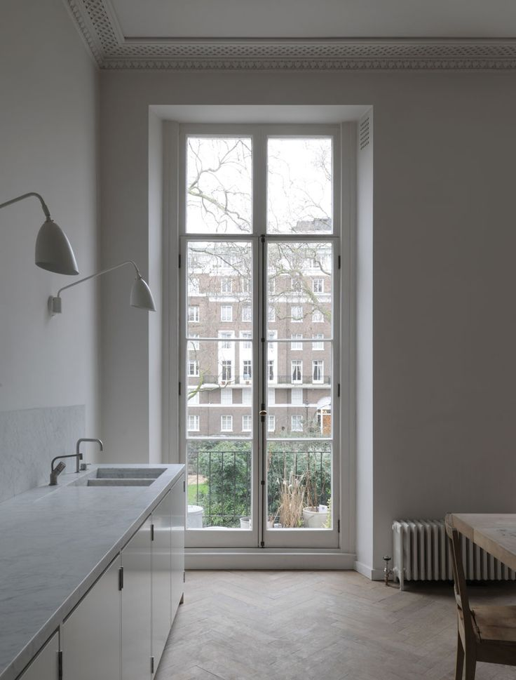 drdh architects / bryanston square apartment, marylebone Wall light above work surface under roof light in kitchen