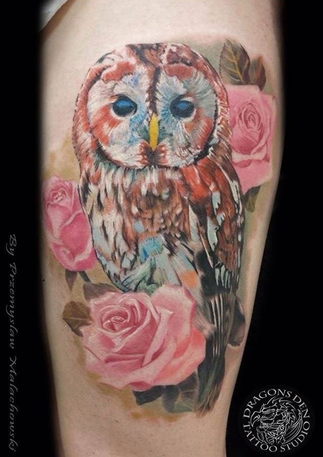Stunning watercolor styled barn owl tattoo.