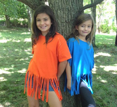 Super easy to make DIY fringe t-shirt project.  Just snip, snip and you turn a boring T into an adorable t-shirt for the girls.  Great girls craft project, camp project or girl scout project. Find $3 shirts at your local craft store!