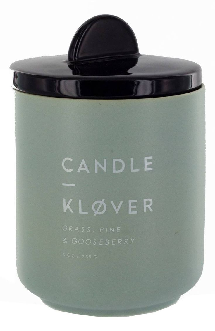 A lovely soy-wax candle in a sleek ceramic vessel is infused with an intoxicating fragrance redolent of Scandinavian forests.