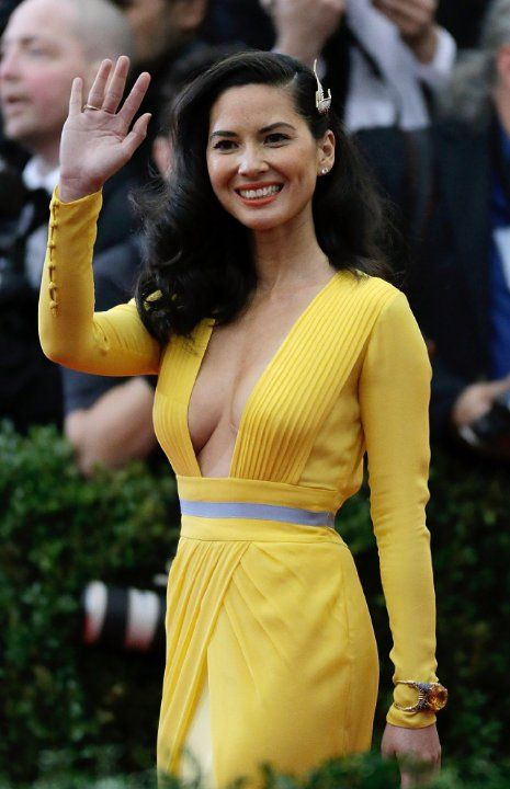 love the style of the dress-- minus the grey waistband and the cream section of the skirt. Obviously the dress would have to be in a different color, as yellow-colored clothing is a major no-no for me (Olivia Munn)