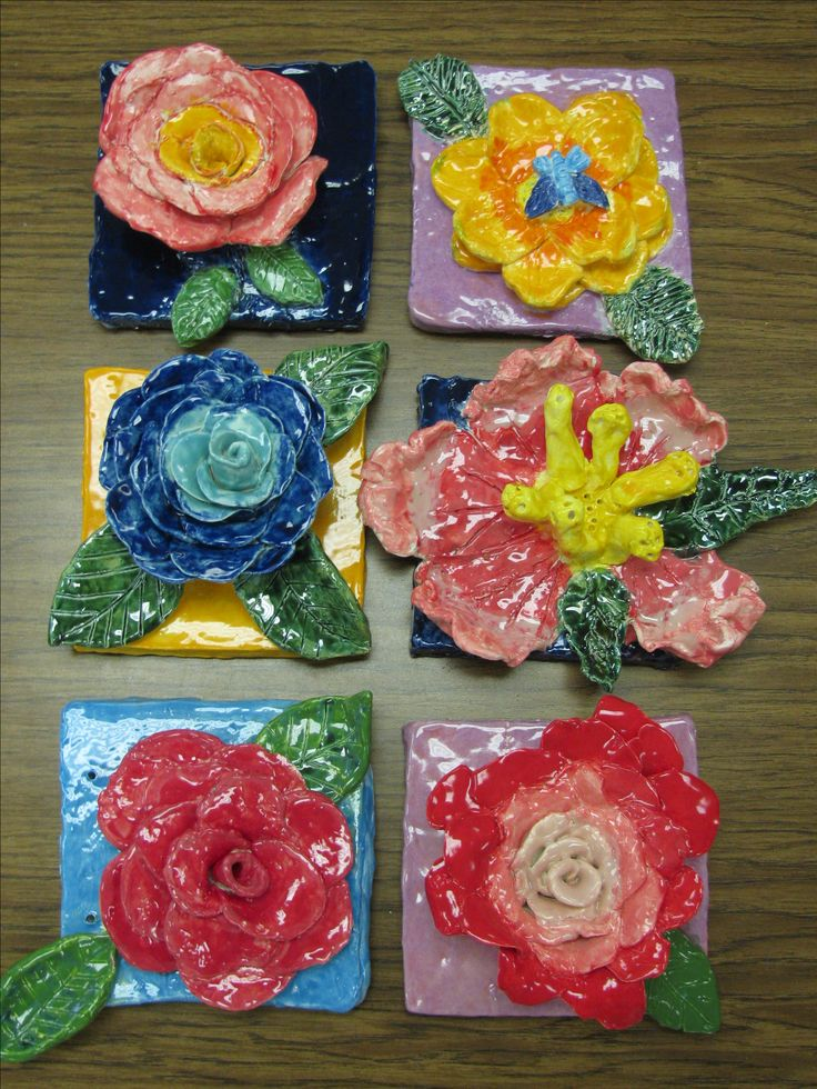 4th grade ceramic flower sculptures; glazed with Speedball brand and Amaco brand glazes. lesson by art teacher: Susan Joe