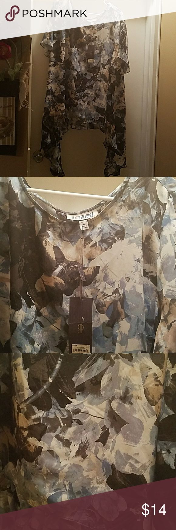 ANOTHER BEAUTIFUL BLOUSE CAN'T SAY ENOUGH ABOUT RHIS BLOUSE FROM JENNIFER LOPEZ SIZE 2X VERY FLOWY THIS BLOUSE WOULD BE GREAT FOR A CRUISE, OR VACATION ON A ISLAND, OR ANY TIME Jennifer Lopez Tops Blouses
