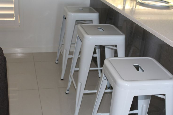 66cm White Rocket Stools. Super Amart currently $25. Furnishing a family-friendly home on a budget. www.mumscloset.com.au