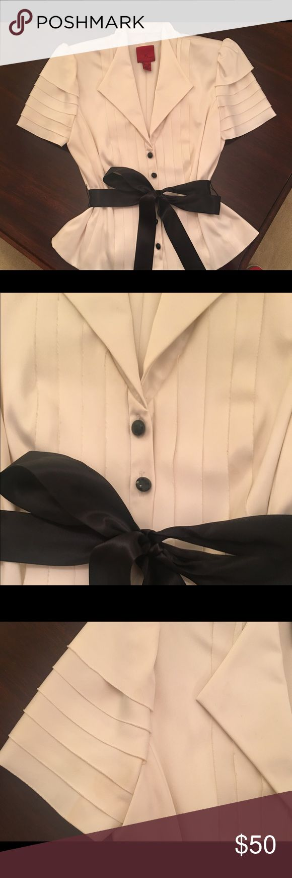 Ivory Satin Tuxedo Style Jacket Size 8 Stunning Ivory satin jacket with tuxedo pleats down the front. Sleeves also accented with pleats for a very sophisticated look. Black satin belt that ties in a bow in the front. Looks great with a black satin skirt or pants. Comes from a smoke and pet free home. JS Collections Jackets & Coats Blazers