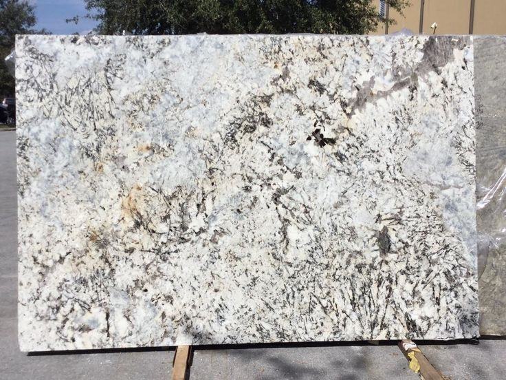#Arcticice #granite is a stunning #naturalstone that looks just like it sounds. It combines stunning icy whites with white, black and grays to create complex patterns that look incredible. Arctic is perfect #granitecountertop slab for any color #kitchencabinet and #kitchenisland.