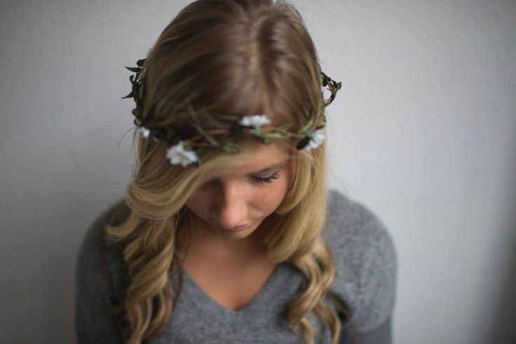 A floral crown is such a gorgeous alternative to a veil, especially for your flower girl, if paired with a lovely pomander.  #flowercrown #ravenluxuryevents #floralcrown #wedding #weddingflowers  Photo Source: https://www.pexels.com/photo/woman-in-gray-v-neck-t-shirt-with-head-wreath-129914/