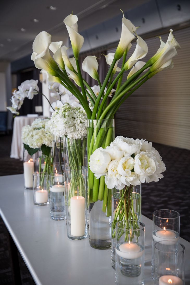Modern White Reception Flowers   mkPhoto https://www.theknot.com/marketplace/mkphoto-west-chester-pa-246928   Rebecca Richman   Petals Lane https://www.theknot.com/marketplace/petals-lane-philadelphia-pa-289171