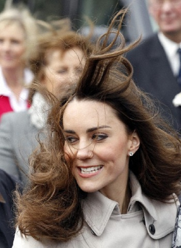 The wind catches Duchess Kate's hair, as she leaves Hillsborough Castle in Belfast, Northern Ireland